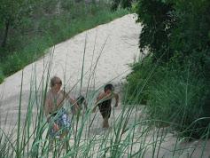 Boys in dunes